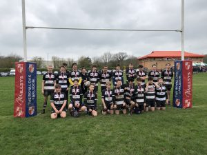 young rugby club posing on the field